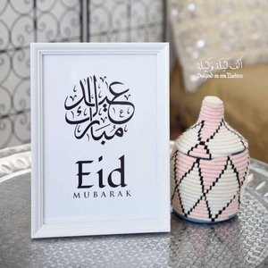 Witte kader Eid Mubarak kalligrafie